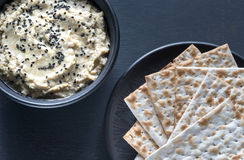 Bowl of baba ghanoush with matzo Royalty Free Stock Images