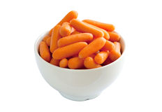 Bowl of Baby Carrots. Isolated over a white background royalty free stock photos