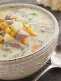 Bowl of Bacon and Corn Chowder with Soda Bread. With spoon Stock Photos
