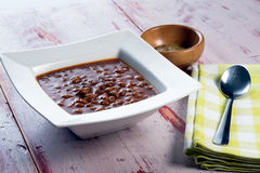 Bowl of baked beans. A bowl of baked beans on a rustic tabletop Royalty Free Stock Photo