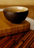 Bowl on bamboo. Asian inspired bowl on bamboo Royalty Free Stock Images