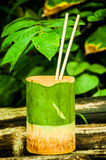 Bowl in bamboo Stock Images