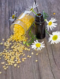 Bowl of bath salt and essential oil. Bowl of chamomile bath salt and essential oil Stock Image