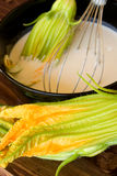 Bowl With Batter And Zucchini Flowers Royalty Free Stock Photos