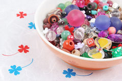 Bowl of beads and buttons. Craft supplies Stock Photos