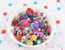 Bowl of beads and buttons. Craft supplies Stock Image