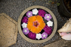 Bowl of beautiful flowers in spa area Stock Photo