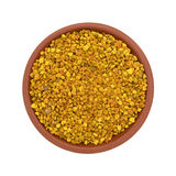 Bowl of bee pollen granules on a white background Stock Photography