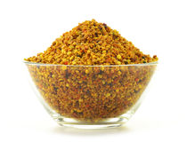 Bowl with bee pollen isolated on white. Nutritional supplement Stock Photos