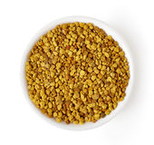 Bowl of bee pollen isolated on white, from above stock photography