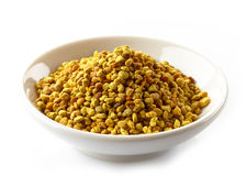 Bowl of bee pollen. On a white background stock image