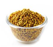Bowl of bee pollen. On a white background stock photos