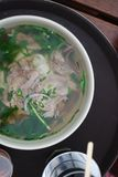 Bowl of beef pho close up look. Vietnamese traditional rice noodle soup with beef. Royalty Free Stock Photos