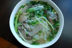 Bowl of beef pho close up look. Vietnamese traditional rice noodle soup with beef. Stock Image