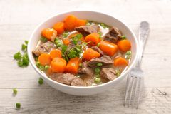 Bowl of beef stew. And carrot Stock Image