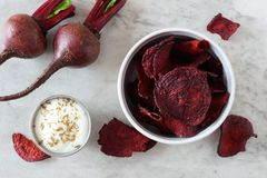 Bowl of beet chips above view over white marble Stock Photography