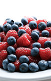 Bowl of berries. Close up of mixed berries in a bowl - shot in studio Stock Photography