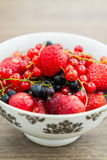 Bowl with berries. Close-up bowl with strawberries, blackberry and red currant royalty free stock photography