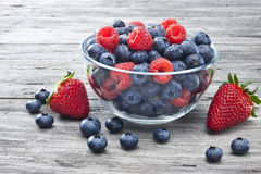 Bowl Berries Fruit Food. A bowl of fresh berries on a rustic wood background royalty free stock photography