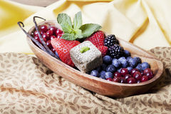 Bowl with berries and mint candy Royalty Free Stock Photography