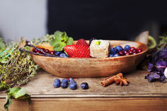 Bowl with berries and mint candy Royalty Free Stock Images