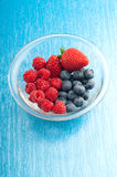 Bowl of berry mix Stock Photos