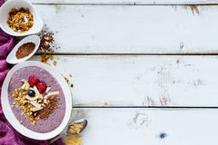 Bowl of berry smoothie Stock Photo