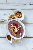 Bowl of berry smoothie Stock Images