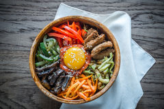 Bowl of bibimbap on the wooden table Stock Photo