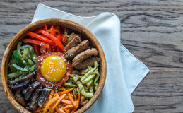 Bowl of bibimbap on the wooden table Stock Photos