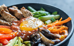Bowl of bibimbap. On the wooden table: top view Stock Image