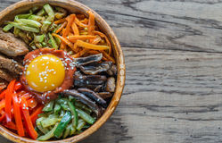 Bowl of bibimbap on the wooden table Stock Image