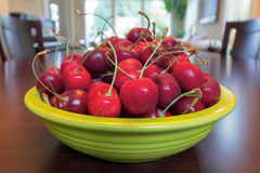 Bowl of Bing Cherries on Dining Table Royalty Free Stock Photos