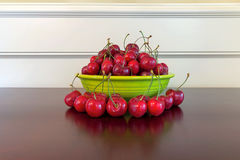 Bowl of Bing Cherries on Wood Table Royalty Free Stock Photography