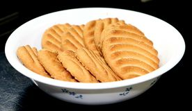 Bowl of Biscuits on the table stock images