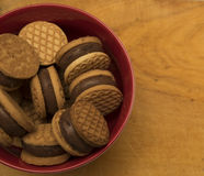 Bowl biscuits on woden surfacebowl biscuits on woden surface Royalty Free Stock Image