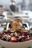 Bittersweet Salad. Bowl of bittersweet salad with oranrges, radicchio, ricotta cheese and pomegranate seeds. Table served for family and friends. Selective focus stock photo