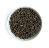 Bowl with black pepper Stock Images