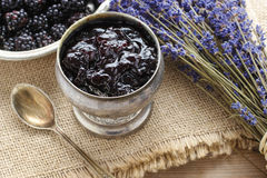 Bowl of blackberry jam Stock Photos