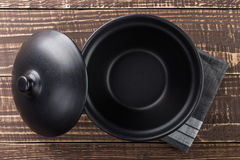 Bowl blank space on wood top view. Black bowl blank space on wood top view Royalty Free Stock Photo