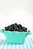 Bowl of blueberries on lines vertical Stock Photography