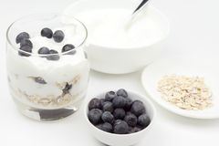 A bowl of blueberries next to a bowl of oatmeal, a bowl of yogur Royalty Free Stock Photography