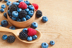 Bowl with blueberries, strawberries and blackberries Stock Image