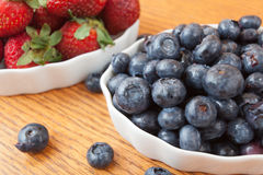 Bowl of blueberries and strawberries Stock Photos