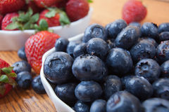 Bowl of blueberries and strawberries Stock Images