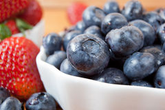 Bowl of blueberries and strawberries Stock Image