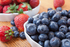 Bowl of blueberries and strawberries Stock Photo