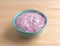 Bowl of blueberry gourmet yogurt on a wood table Royalty Free Stock Photo