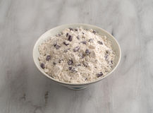 Bowl of blueberry muffin mix on a marble cutting board. Stock Image