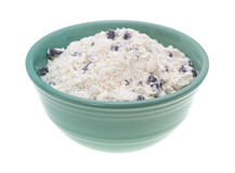Bowl of blueberry muffin mix on a white background. Royalty Free Stock Photography